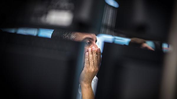 Trading on the Frankfurt stock exchange. (Photo by Frank Rumpenhorst/DPA/Corbis)