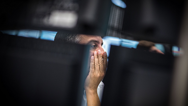 Trading on the Frankfurt stock exchange. (Photo by Frank Rumpenhorst/DPA/Corbis)