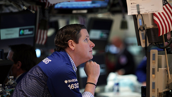 A trader works on the floor of the New York Stock Exchange. (Photo by Spencer Platt / Getty Images)