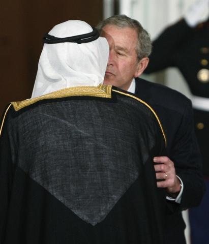 President George W. Bush kisses King Abdullah of Saudi Arabia.