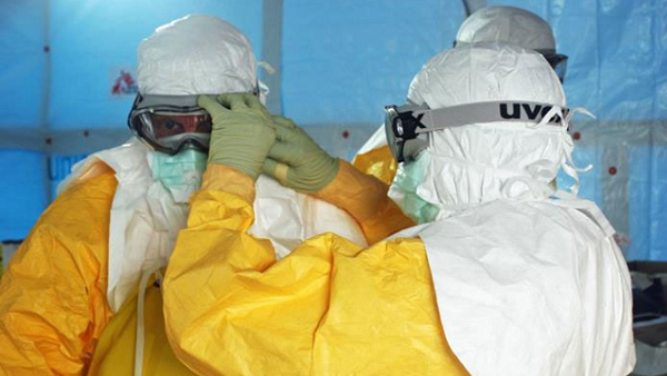 Health care workers put on protective gear before entering an Ebola treatment unit in Liberia. (Photo: CDC/Sally Ezra/Athalia Christie)