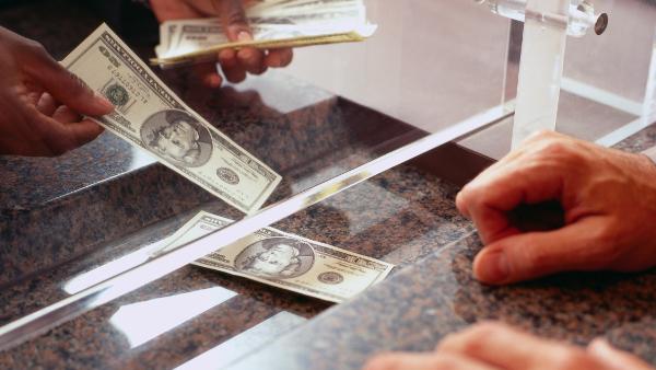 handing cash