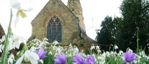 Lullington Church with spring flowers (Photo by Brian Webster) (CC BY) (Resized/Cropped)