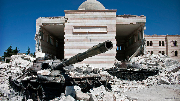 Destroyed Syrian tanks in Azaz, Syria (Photo by Christiaan Triebert) (CC BY) (Resized/Cropped)