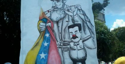 Political cartoon showing President Nicolas Maduro as a puppet of Fidel Castro