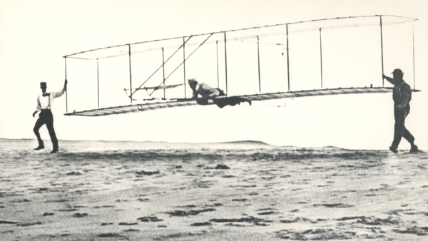 Wright brothers' third test glider being launched at Kill Devil Hills, North Carolina, October 1902