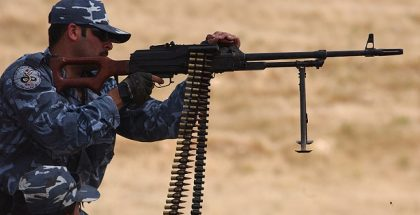 An Iraqi police officer fires a rifle while training with international police liaison officers and members of the Civilian Police Assistance Training Team at Forward Operating Base Marez in Mosul, Iraq, May 1, 2007. (U.S. Air Force photo by Staff Sgt. Vanessa Valentine) (Released)