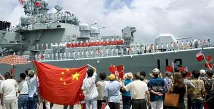 060906-N-4856G-040 Pearl Harbor, Hawaii (Sept. 06, 2006) - Local spectators wave aloha to the Chinese Navy destroyer Qingdao (DDG 113) while mooring at the pier in Pearl Harbor. Two ships representing ChinaÕs Navy, the destroyer Qingdao (DDG 113) and the oiler Hongzehu (AOR 881) arrived in Pearl Harbor for a routine port visit. During their visit, ChinaÕs sailors will have the opportunity to interact with their U.S. counterparts and experience the unique culture of Hawaii. U.S. Navy photo by Mass Communication Specialist 3rd Class Ben A. Gonzales (RELEASED)